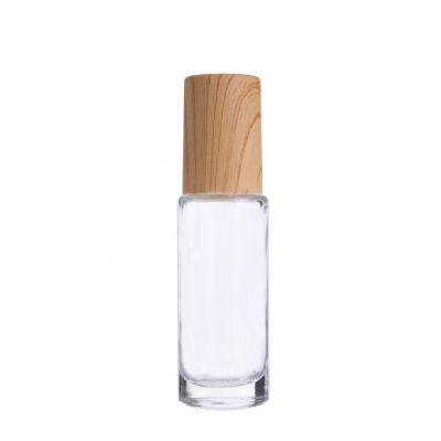 5ml clear empty eye cream cosmetics glass roller bottle with wood grain cap and glass roller ball